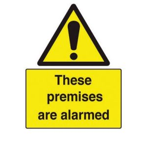 These premises are alarmed signF90415